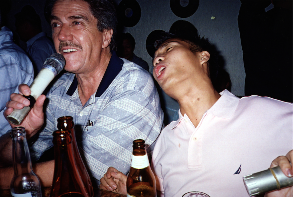 Alex Pagulayan and Cliff Thorburn sing in a local bar after Alex's 2004 World Pool Championship win in Taipei, Taiwan...